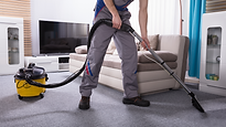 Carpet cleaning professional in gray ove