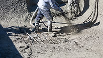 Man in boots pouring concrete.jpg
