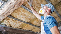 Man installing roof insulation.jpg