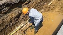 Clearing soil for pipe installation.jpg