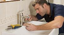Plumber repairing faucet.jpg