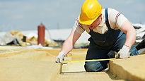 Man in white shirt measuring for insulat