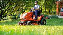 Man riding his lawn mower.jpg