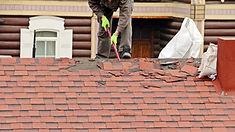 Man installing tiles on roof.jpg