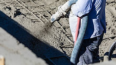 Man working with concrete cement.jpg