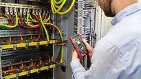 Electrical engineer checking voltage.jpg