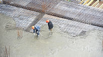 2 men pouring heavy concrete.jpg