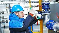 Plumber repairing water pipes.jpg