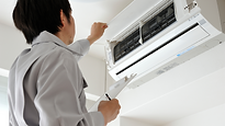 Man checking the white air conditioner.p