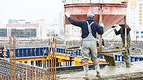 2 men pouring concrete.jpg