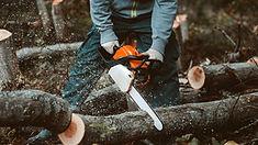 Man using a chainsaw.jpg