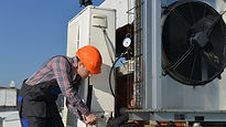 Man doing air conditioning repairs.jpg