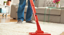 Cleaning a white carpet using vacuum.jpg