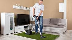 Man in white shirt carpet cleaning.jpg
