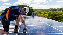 Man in installing solar panels.jpg