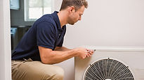 Man in polo shirt installing air conditi
