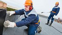 Roofers installing roof felth.jpg