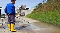 Pressure washing  the ground.jpg