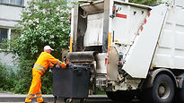 Man putting junk in truck.jpg