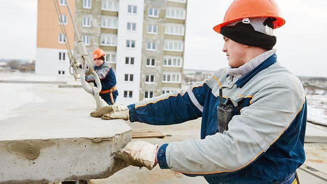 Man handling a concrete slab.png