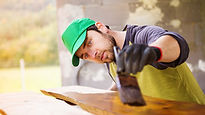 Man painting a wooden slab.jpg