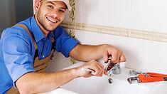 Smiling plumbing repairing sink.jpg