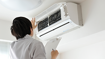 Man checking the air conditioner.png