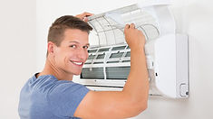 Smiling man cleaning filters.jpg