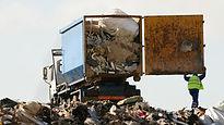 Man disposing junk at site.jpg