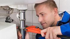 Plumber working on sink.jpg