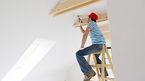 Man on a ladder painting the roof.jpg