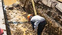 Man in muddy soil.jpg