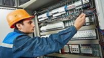 Electrician in blue overalls.jpg