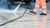 Pressure washing the cemented ground.jpg