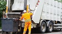 Man putting junk in white truck.jpg