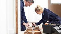 Plumber with female apprentice.jpg