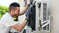 Man installing the air conditioning syst