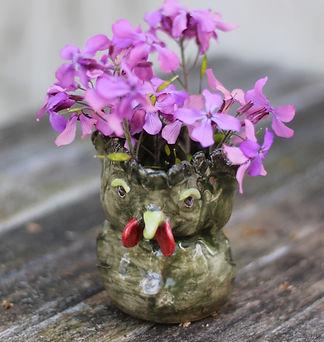 keramik_grøn_høne_med_blomst.jpg