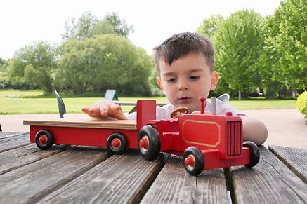 Child with wooden tractor.jpg