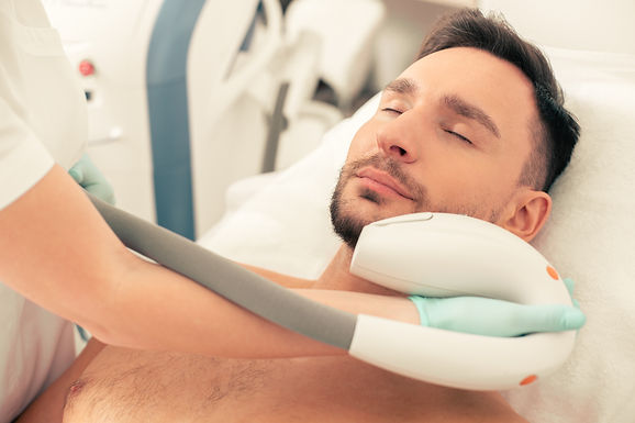 calm-bearded-man-lying-with-closed-eyes-looking-relaxed-while-undergoing-painless-photo-re