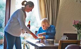 Live-in-respite-care-carer-serving-old-l