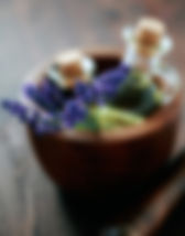 wooden bowl aromatherapy oils glass bottle flowers massage holistic