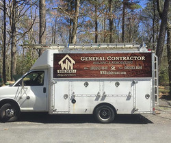 WN Builders box truck with a partial wrap