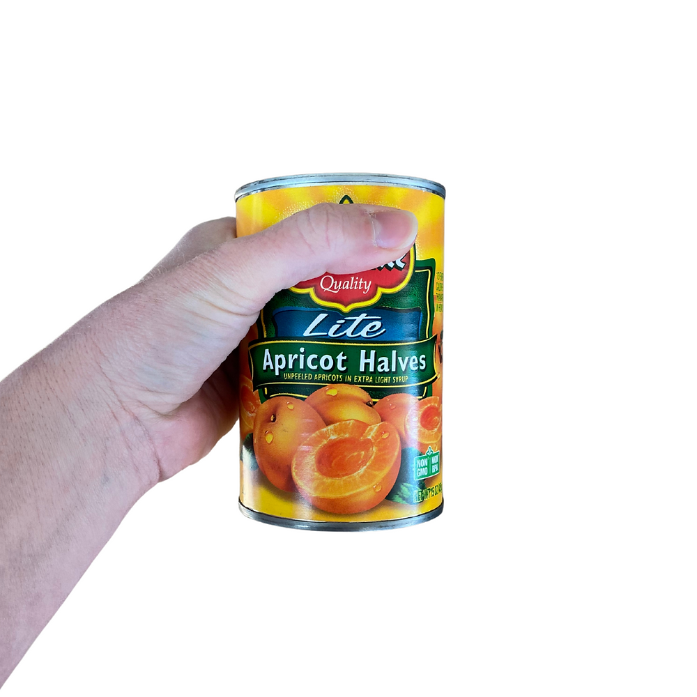 hand holding canned apricot halves