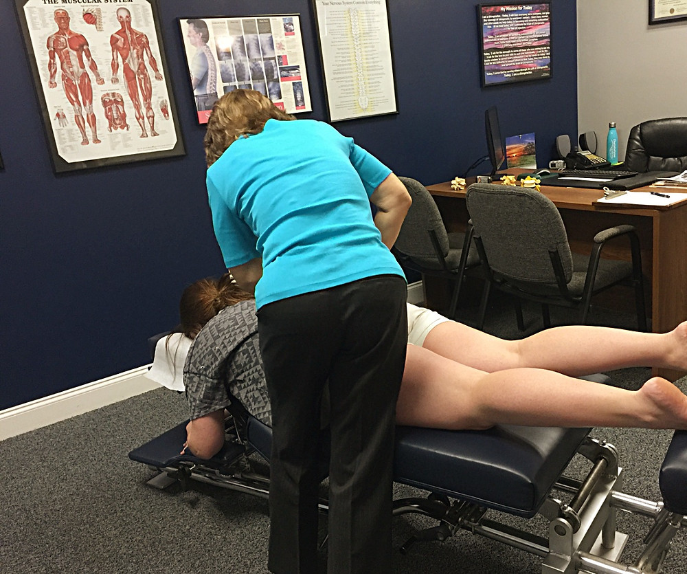 Dr. Kelley Helmendach adjusts pelvic of full term mom | chiropractic care for pregnant mom | Charlotte Chiropractor