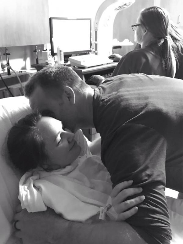 Dad congratulates mom on natural birth