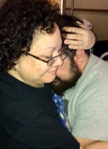 Mom hugs son after birth of grandbaby