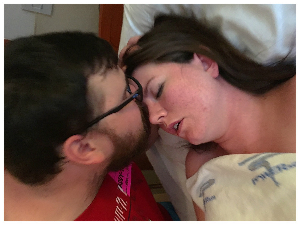Dad kisses Mom during hard labor contractions