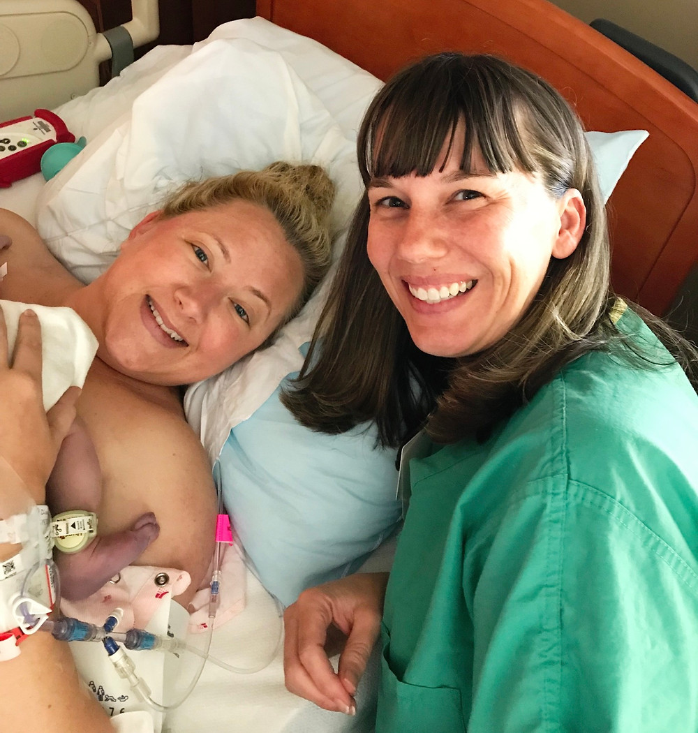 Midwife Tammy Reyes assists Mom with final vacuum assist during crowning to rectify asynclitic head position