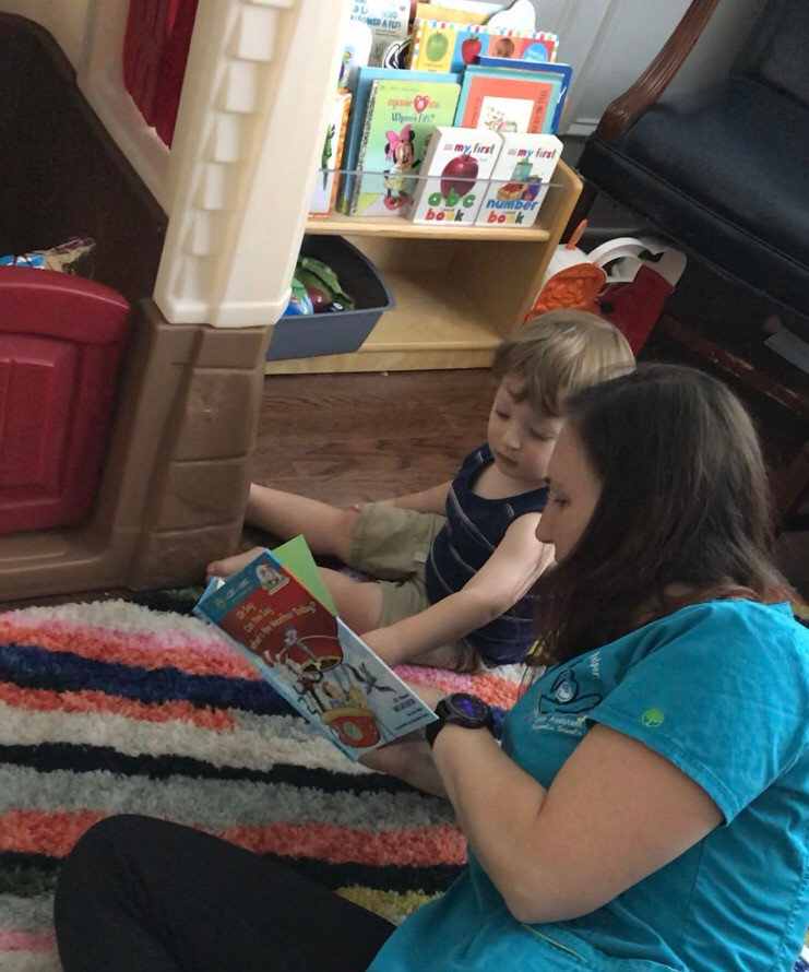 Doula helps oversee two year old son while mom labors